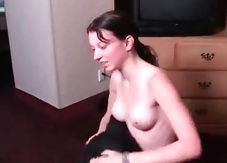 Juicy brunette is being fucked in the bed
